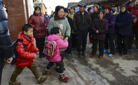 Students return to school in Chengping, Henan, after the stabbing that took place on December 14
