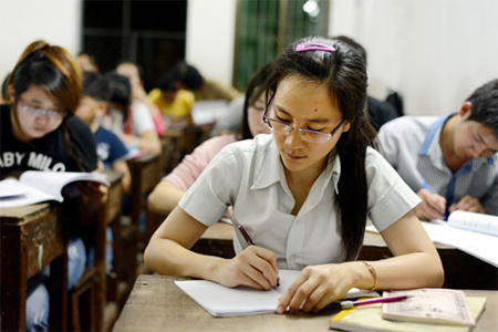 Students write Chinese idioms and proverbs at the Duan Hua School in Phnom Penh earlier this week. Photograph: Ruth Keber