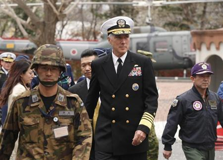 U.S. Admiral Samuel Locklear (C), Commander of the U.S. Pacific Command, is accompanied by Shigeru Iwasaki (R), Chief of Japan's Self-Defence Forces Joint Staff, as he arrives to inspect the Patriot Advanced Capability-3 (PAC-3) land-to-air missile deployed at the Defence Ministry in Tokyo April 11, 2012