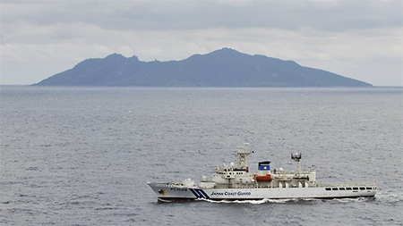 A Japanese ship patrols close to the largest of the Senkaku Islands