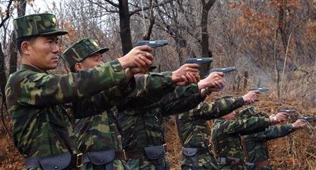 North Korean soldiers take part in a shooting drill in an unknown location