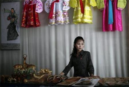 Woman standing in North Korean shop