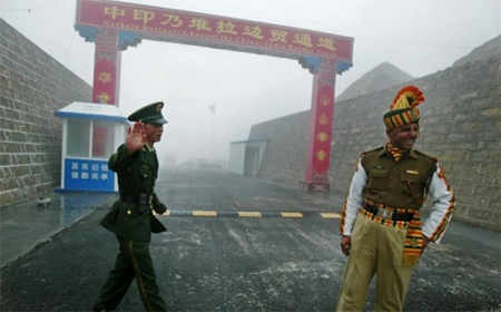 A Chinese soldier with an Indian soldier at a border crossing on the ancient Silk Road.