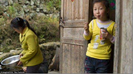 Preparations: Yu Xinxin's morning routine is just like any other schoolgirl's until she leaves home to make the dangerous journey down the mountain