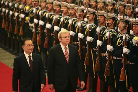 Kevin Rudd, whose comments on Tibet have piqued the Chinese leadership, reviews a military guard in the Great Hall of the People with then Premier, Wen Jiabao in 2008