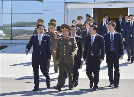 Choe Ryong-hae (C), director of the General Political Bureau of the Korean People's Army (KPA) of North Korea, walks with Chinese Ambassador Liu Hongcai (2nd R) before departing Pyongyang airport for China
