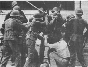 Ten armed soldiers beating a student to death in Tiananmen Square during the massacre (June 4)