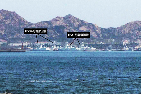 Two type 054A missile frigates and two type 051C missile destroyers at aircraft carrier port. Source: mil.huanqiu.com