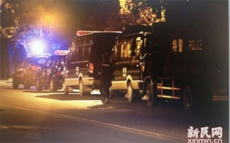 Police and SWAT vehicles seen parked along a road near the scene of the murders. Photo: SCMP Pictures