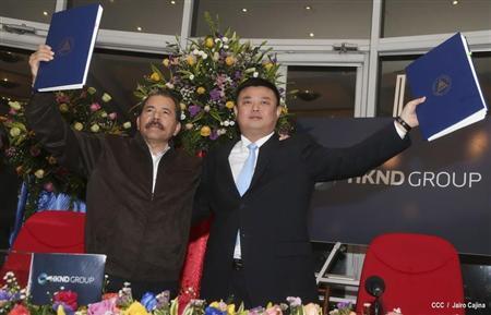 Nicaragua's President Daniel Ortega (L) and Wang Jing, chairman of the Hong Kong international company Nicaragua Canal Development Investment Co.