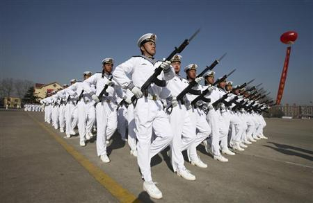 New recruits of the Chinese Navy march with their guns during the parade marking the end of their first training session in Qingdao, Shandong province, March 4, 2013. Credit: Reuters/Stringer