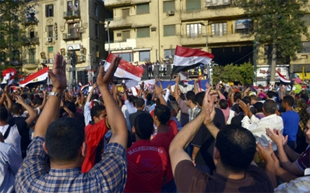 Egyptians celebrate at Tahrir square, one day after bloody clashes between supporters of ousted Egyptian President Mohammed Mursi and the opponents in Cairo. Photo: EPA