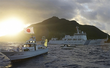 A Chinese surveillance ship and Japanese ship sail near the Senkaku Islands in the East China Sea