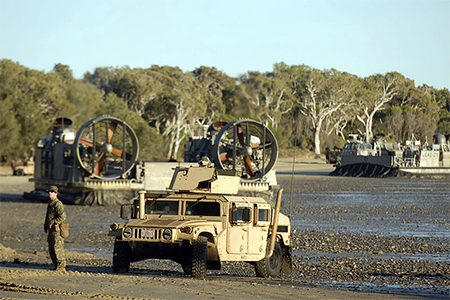 Marines assigned to the 31st Marine Expeditionary Unit (31st MEU) deployed to the amphibious assault ship USS Essex (LHD 2) prepare to patrol in light armored vehicles during an exercise at Freshwater Bay supporting Talisman Saber 2009. Talisman Saber is a joint exercise between the U.S. and the Australian Defense Force that includes participation from more than 20,000 U.S. and 10,000 Australian personnel.