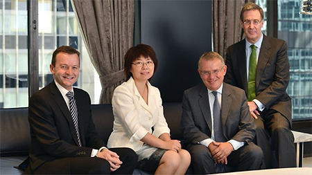 Stuart Fuller, left, global managing partner of King & Wood Mallesons; Wang Ling, the firm's managing partner for China; SJ Berwin's senior partner, Stephen Kon; and King & Wood Mallesons chairman for Australia, Stephen Minns