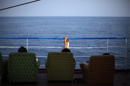 A Chinese delegation relaxes on the inaugural trip of the Mangyongbyong cruise ship in 2011
