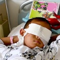 A six-year-old boy, whose eyes were gouged out, lies on a hospital bed in Taiyuan, Shanxi province, August 27, 2013. - JON WOO / REUTERS