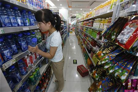 A customer selects a product at a supermarket in Beijing
