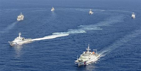 Vessels from the China Maritime Surveillance and the Japan Coast Guard are seen near disputed islands, called Senkaku in Japan and Diaoyu in China, in the East China Sea