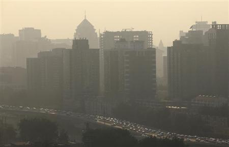 Vehicles past apartment blocks during rush hour in Beijing