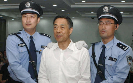 Bo Xilai, handcuffed and flanked by guards, after the guilty verdict was announced
