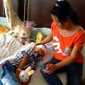The boy recuperates Wednesday near his mother from an attack in the rural area of Linfen city that left him blind.