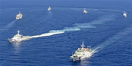 Vessels from the China Maritime Surveillance and the Japan Coast Guard are seen near disputed islands, called Senkaku in Japan and Diaoyu in China, in the East China Sea, in this photo taken by Kyodo September 10, 2013. Mandatory Credit. Credit: Reuters/Kyodo