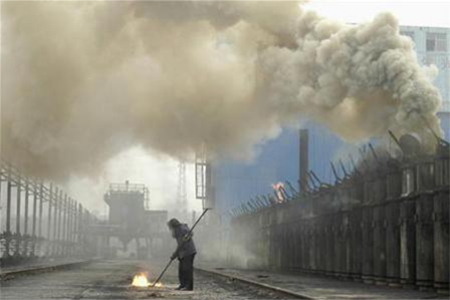 A labourer works at a coking plant in Changzhi, north China's Shanxi province