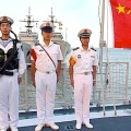 Chinese sailors stand on board a frigate berthed in Shanghai. Guillaume Klein/AFP/Getty Images