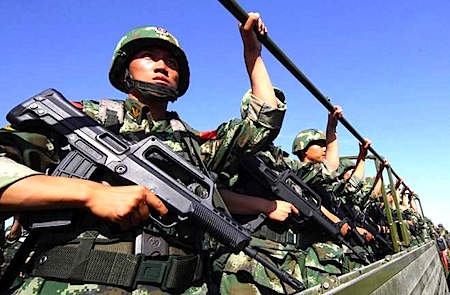 An anti-terrorism force including public security police and the armed police attend an anti-terrorism joint exercise in Hami, northwest China's Xinjiang region on July 2, 2013. STR / AFP / Getty Images