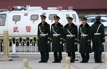Paramilitary policemen stand guard on Tiananmen square next to the Great Hall of the People