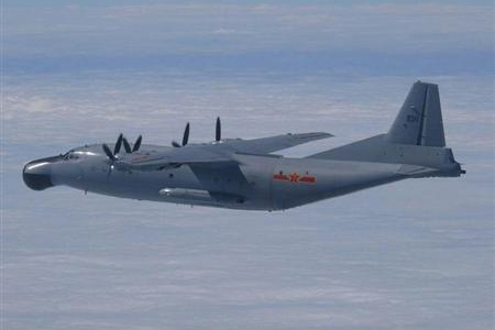 A Chinese military plane Y-8 airborne early warning plane flies through airspace between Okinawa prefecture's main island and the smaller Miyako island in southern Japan, out over the Pacific, in this handout photo taken on October 27, 2013 by the Japan Air Self-Defence Force and released by the Joint Staff Office of the Defense Ministry of Japan