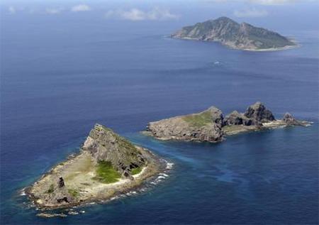 A group of disputed islands, Uotsuri island (top), Minamikojima (bottom) and Kitakojima, known as Senkaku in Japan and Diaoyu in China is seen in the East China Sea