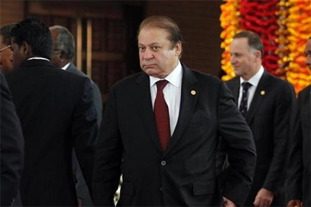 Pakistan's Prime Minister Nawaz Sharif arrives for the official photograph of the Commonwealth heads of states during the opening ceremony of the Commonwealth Heads of Government Meeting (CHOGM) in Colombo November 15, 2013
