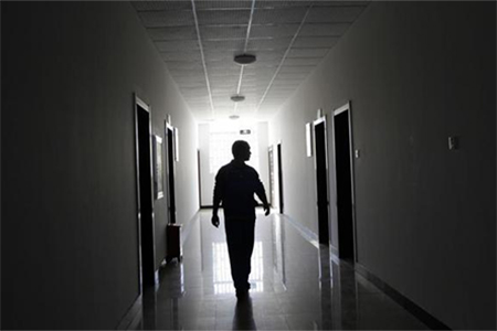 A drug addict walks at a compulsory drug rehabilitation center in Kunming, capital of southern China's Yunnan Province November 28, 2011