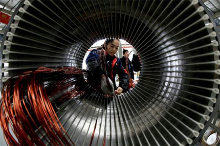 A worker assembles a generator at a factory in Hefei, Anhui province