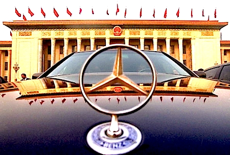 A luxury car driven by a Chinese official is parked in front of the Great Hall of the People in Beijing