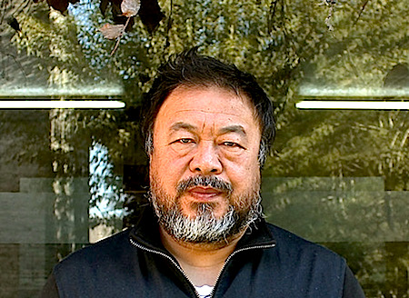 Ai Weiwei outside his studio's main office. Under near-constant surveillance by Chinese authorities, Ai lives and works on the premises. - JEFFREY MARLOW