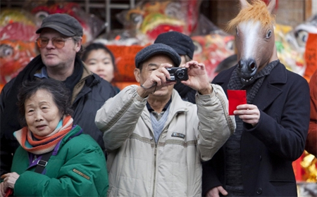 Most applicants for rich investor visas are Chinese wanting to live, like these Lunar New Year revellers, in British Columbia