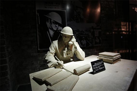 "A model and a photograph of John Rabe, sometimes call ""China's Schindler"", are seen in a museum, during a reporting trip in Nanjing, Jiangsu province"