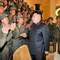 North Korean leader Kim Jong Un is welcomed by a group of soldiers in Pyongyang. (KCNA / EPA / October 29, 2013)