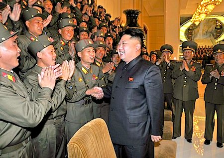 North Korean leader Kim Jong Un is welcomed by a group of soldiers in Pyongyang. (KCNA / EPA / October 29, 2013)