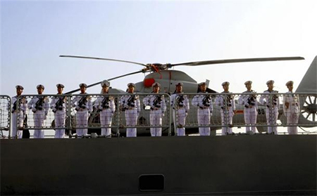 Chinese sailors stand at attention as the Chinese frigate Yancheng comes in to dock at Limassol port in Cyprus
