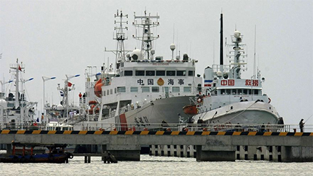 Chinese patrol vessel, the Haixun 31, prepares to leave for search and rescue operations