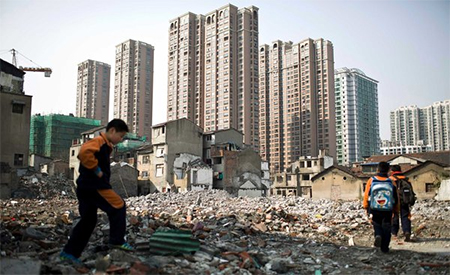 Old homes in downtown Shanghai are being demolished to make way for skyscrapers. A big developer's collapse suggests growing trouble in China's building boom.