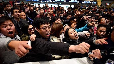 Chinese passengers vent anger over delayed international flight