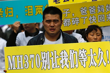 Seemingly encouraged by the Chinese government., angry relatives of Chinese passengers aboard missing Malaysian Airlines Flight MH370 plane protested outside the Malaysian Embassy in Beijing on Tuesday, (Kim Kyung-Hoon / Reuters)