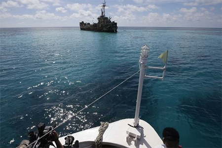 The Philippine boat slipped past the Chinese and reached their troops on a rusty beached vessel