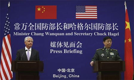 U.S. Secretary of Defense Chuck Hagel (L) and Chinese Minister of Defense Chang Wanquan participate in a joint news conference at the Chinese Defense Ministry headquarters in Beijing April 8, 2014