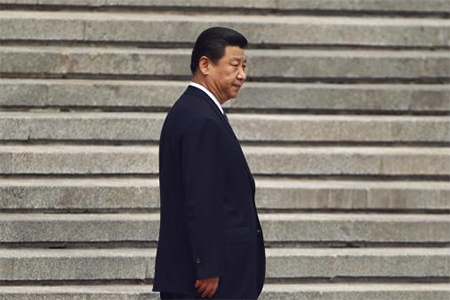 China's President Xi Jinping waits for his Palestinian counterpart Mahmoud Abbas before a welcoming ceremony outside the Great Hall of the People in Beijing, May 6, 2013